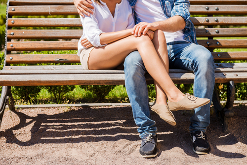 Love and Friends couple cuddling on a park bench